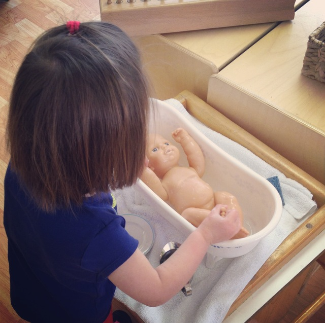 Toddler playing in a Montessori classroom in Cary, NC